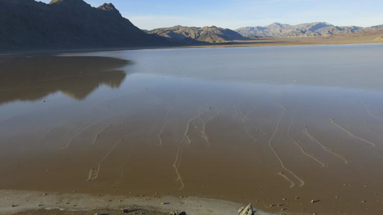 Handout shows trails left by rocks in a shallow lake in the so-called Racetrack Playa of California's Death Valley