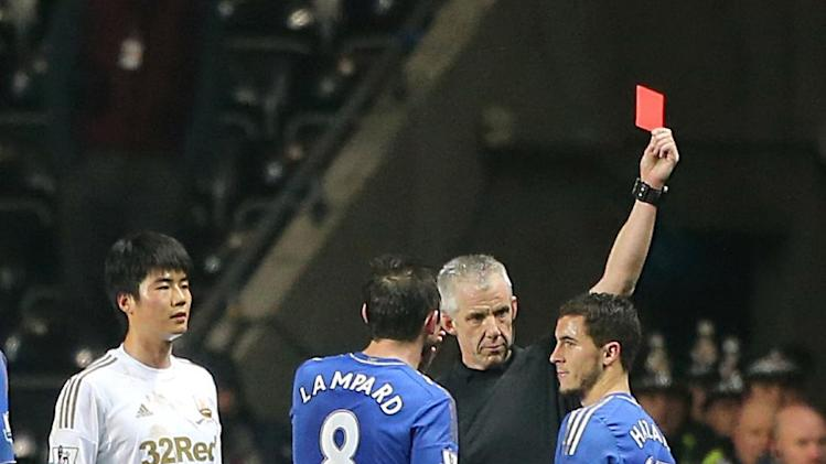 Chelsea's Eden Hazard, right, receives a red card from referee Chris Foy for violent conduct, during their English League Cup second leg semi-final soccer match at the Liberty Stadium in Swansea, Wales, Wednesday Jan. 23, 2013. A ball boy was attended to by officials following an incident with Eden Hazard. (AP Photo/PA, Nick Potts) UNITED KINGDOM OUT  NO SALES  NO ARCHIVE