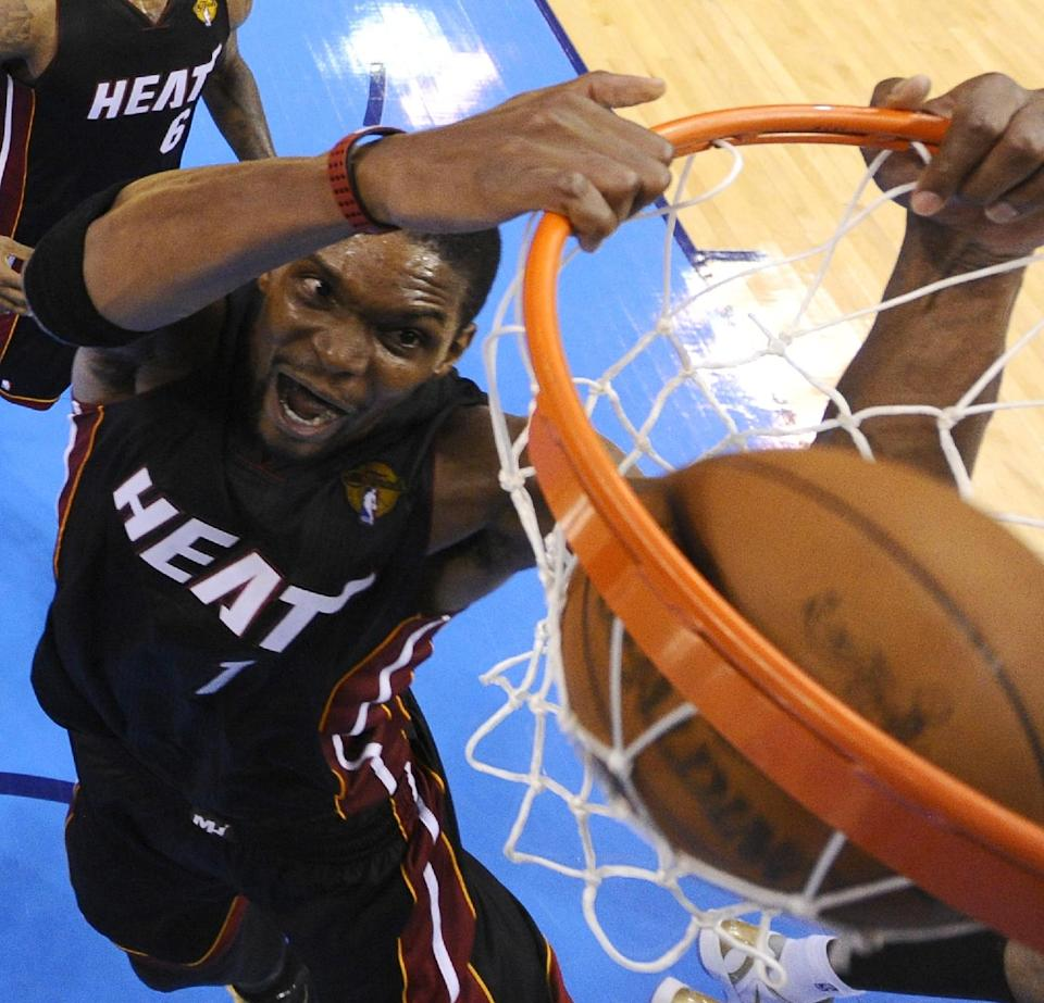 Miami Heat power forward Chris Bosh  dunks against the Oklahoma City Thunder during the second half at Game 2 of the NBA finals basketball series, Thursday, June 14, 2012, in Oklahoma City. The Heat won 100-96. (AP Photo/Larry W. Smith, Pool)