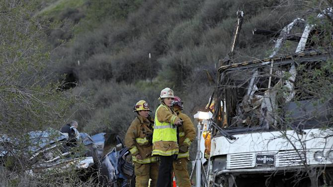San Bernardino  Investigators examine wreckage Monday Feb. 4, 2012, after a tour bus accident in the Southern California mountains near San Bernardino.  The accident Sunday killed at least 8 people.  ( AP Photo/Nick Ut)