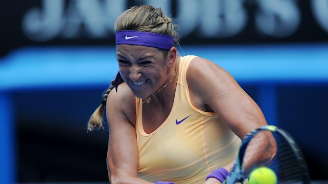 Victoria Azarenka of Belarus makes a backhand return to Greece's Eleni Daniilidou during their second round match at the Australian Open tennis championship in Melbourne, Australia, Thursday, Jan. 17, 2013. (AP Photo/Andrew Brownbill)