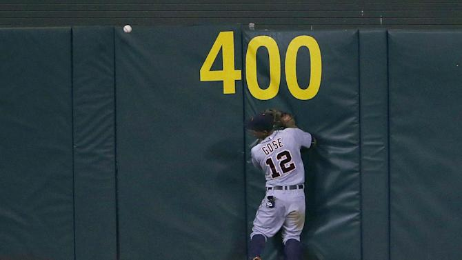 Detroit Tigers center fielder Anthony Gose cannot catch a ground-rule double hit by Oakland Athletics' Ben Zobrist during the fifth inning of a baseball game in Oakland, Calif., Tuesday, May 26, 2015. (AP Photo/Jeff Chiu)