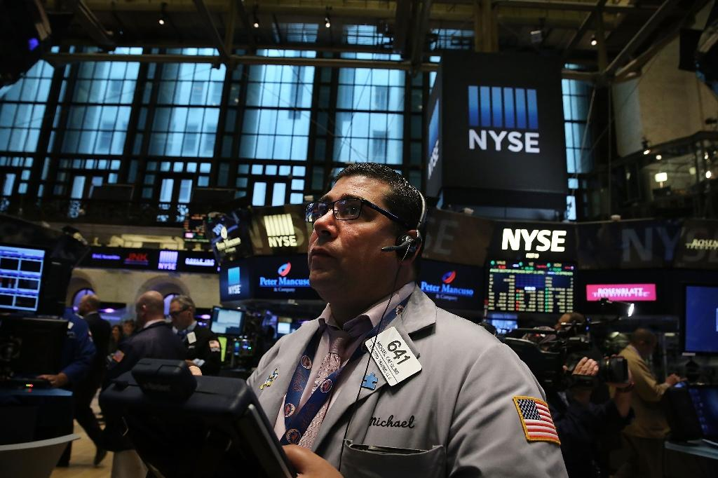 US stocks gain despite weak Adobe, Yum