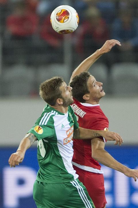 Thun's Fulvio Sulmoni, right, vies for the ball against Vienna's Guido Burgstaller, left, during the UEFA Europa League group G soccer match between Switzerland's FC Thun and Austria's SK Rapid Vienna