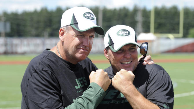 New York Jets coach Rex Ryan, left, poses with defensive assistant Jeff Weeks at NFL football training camp on Friday, July 26, 2013, in Cortland, N.Y. (AP Photo/Bill Kostroun)