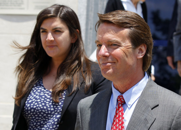 John Edwards, right, leaves a federal courthouse during the eighth day of jury deliberations with his daughter Cate, left, in his trial on charges of campaign corruption in Greensboro, N.C., Wednesday, May 30, 2012. The judge in John Edwards' campaign corruption trial says she has received a note from a juror on Wednesday. (AP Photo/Chuck Burton)