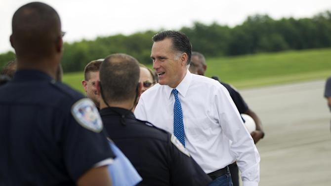 Republican presidential candidate, former Massachusetts Gov. Mitt Romney shakes hands after arriving at Louis Armstrong New Orleans International Airport in New Orleans, Tuesday, Aug. 21, 2012.  (AP Photo/Evan Vucci)