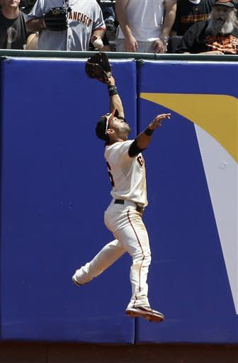 Sanchez lifts Giants over Brewers in 11 innings