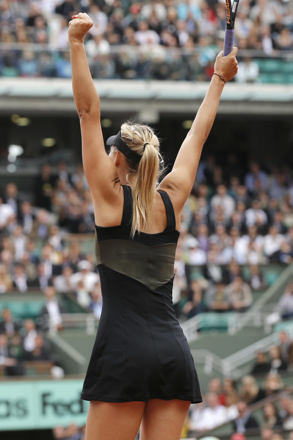 Maria Sharapova of Russia celebrates winning her quarter final match against Kaia Kanepi of Estonia at the French Open tennis tournament in Roland Garros stadium in Paris, Wednesday June 6, 2012. Sharapova won in two sets, 6-2, 6-3. (AP Photo/Christophe Ena)