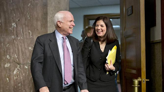 Senate Armed Services Committee members Sen. John McCain, R-Ariz., left, and Sen. Kelly Ayotte, R-N.H., arrive for a hearing on the appointments of military leaders, Thursday, Feb. 14, 2013, on Capitol Hill in Washington. The Republicans on the committee have been vocal in their opposition to the nomination of Chuck Hagel to be the next secretary of defense. (AP Photo/J. Scott Applewhite)