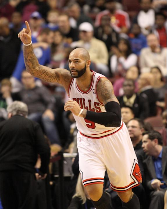 Chicago Bulls' Carlos Boozer (5) celebrates after he scored against the Philadelphia 76ers in the first half of an NBA basketball game Saturday, Nov. 2, 2013, in Philadelphia