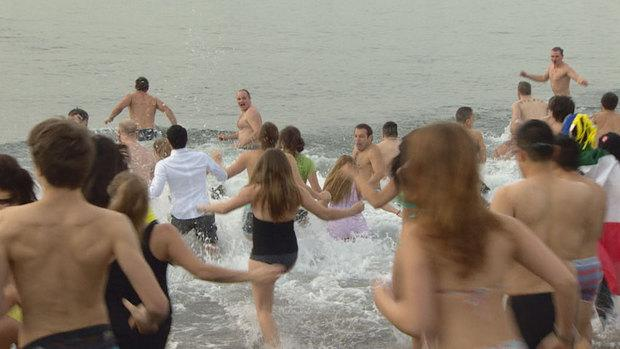 Thousands packed into the waters of English Bay for the 93rd annual polar bear swim.