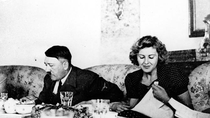 "FILE - This undated file picture shows the German Fuehrer Adolf Hitler and his mistress Eva Braun while dining. A German woman named Margot Woelk was one of 15 young women who sampled Hitler's food to make sure it wasn't poisoned before it was served to the Nazi leader in his ""Wolf's Lair,"" the heavily guarded command center in what is now Poland, where he spent much of his time in the final years of World War II. Margot Woelk kept her secret hidden from the world, even from her husband then, a few months after her 95th birthday, she revealed the truth about her wartime role. (AP Photo/US Army Signal Corps from Eva Braun's album, File)"
