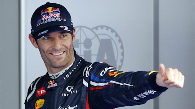 Mark Webber celebrates taking pole position at the Korean GP