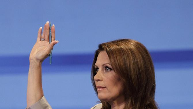 Republican presidential candidate Rep. Michele Bachmann, R-Minn., gestures during the Iowa GOP/Fox News Debate at the CY Stephens Auditorium in Ames, Iowa, Thursday, Aug. 11, 2011. (AP Photo/Charlie Neibergall, Pool)