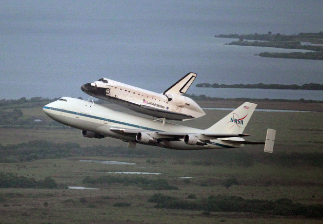 Space shuttle Endeavour, bolted atop a modified jumbo jet, makes its departure from the Kennedy Space Center, Wednesday, Sept. 19, 2012, in Cape Canaveral, Fla. Endeavour will make a stop in Houston b