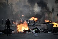 Shiite Bahraini protestors clash with security forces following a rally to mark the second anniversary of an uprising in the Sunni-ruled kingdom of Bahrain in the village of Sanabis, west of the capital Manama on February 14, 2013