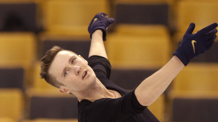Jeremy Abbott skates during practice at the U.S. Figure Skating Championships Wednesday, Jan. 8, 2014 in Boston. (AP Photo/Steven Senne)