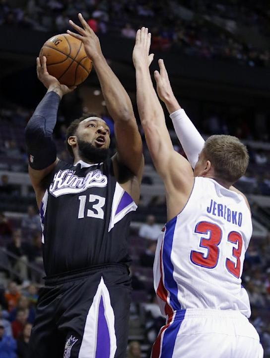 Sacramento Kings forward Derrick Williams (13) takes a shot against Detroit Pistons forward Jonas Jerebko (33) during the first half of an NBA basketball game, Tuesday, March 11, 2014, in Auburn Hills