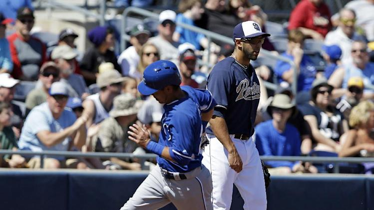 Kansas City Royals' Norichika Aoki runs past San Diego Padres left fielder Alex Castellanos, right, during the first inning of a spring exhibition baseball game Sunday, March 16, 2014, in Peoria, Ariz. Aoki scored on a hit by Omar Infante