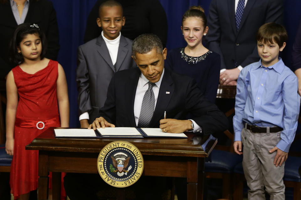 Obama unveils gun plan, concedes tough fight ahead