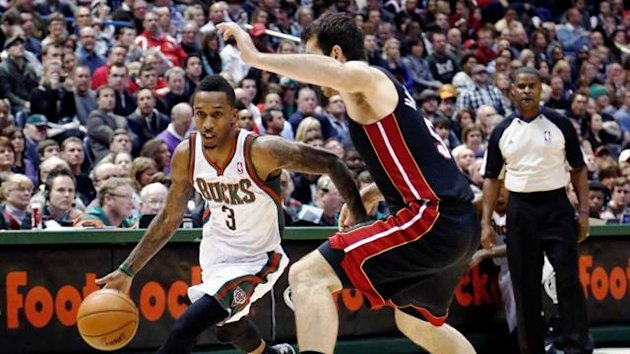 Milwaukee Bucks guard Brandon Jennings drives to the basket against Miami Heat centre Josh Harrellson.