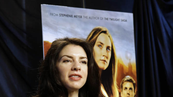 """This Feb. 19, 2013 photo shows author Stephenie Meyer speaking in Miami. Meyer, author of the """"Twilight"""" saga says she's working on a new series.  She wrote """"The Host"""" as an escape from editing of one of the books in the popular vampire series. The movie adaption of """"The Host"""" premieres March 29. (AP Photo/Alan Diaz)"""