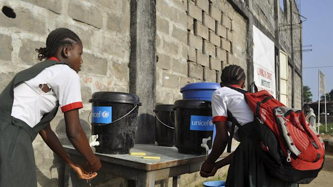 Girls wash their hands as part of Ebola prevention methods, in Paynesville, Liberia