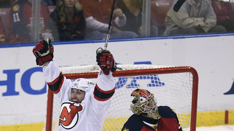 New Jersey Devils' Stephen Gionta (11) celebrates after scoring a goal against Florida Panthers goalie Jose Theodore (60) during the second period of Game 7 in a first-round NHL Stanley Cup playoff hockey series in Sunrise, Fla., Wednesday, April 26, 2012. (AP Photo/J Pat Carter)