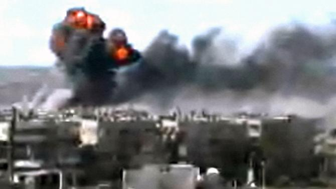 This video image taken from amateur video and broadcast by Bambuser/Homslive shows a series of devastating explosions rocking the central Syrian city of Homs, Syria, Monday, June 11, 2012. Live streaming video caught the devastation during one of the heaviest examples of violence since the uprisings began over a year ago. (Photo/Bambuser/Homslive via AP video)   MANDATORY CREDIT: BAMBUSER/HOMSLIVE