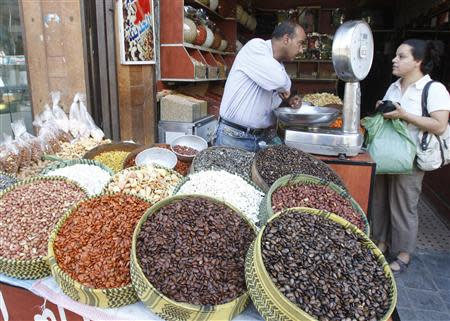 A Syrian woman buys seeds at a market in old Damascus