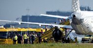 Passengers disembark a plane of Spanish airline Vueling after it landed at Schiphol Airport in Amsterdam. Dutch authorities scrambled fighter jets Wednesday after the feared hijacking of the airliner but it turned out to be a false alarm that officials blamed on &quot;miscommunication.&quot;