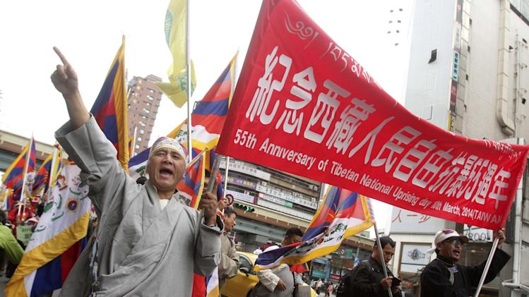 Tibetans living in Taiwan and supporters march during a protest to mark the March 10 anniversary of a failed 1959 uprising against Chinese rule, in Taipei, Taiwan, Sunday, March 9, 2014. (AP Photo/Chiang Ying-ying)