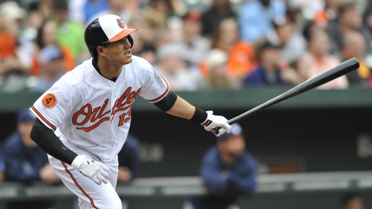 Baltimore Orioles Manny Machado follows through on a triple against the Tampa Bay Rays in the fourth inning of the MLB American League baseball game Sunday, May 19, 2013 in Baltimore. (AP Photo/Gail Burton)