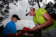 MOBILE, AL - MAY 18:  Stacy Lewis signs autographs for fans after after finishing round three of the Mobile Bay LPGA Classic at the Crossings Course at the Robert Trent Jones Trail at Magnolia Grove on May 18, 2013 in Mobile, Alabama.  (Photo by Chris Trotman/Getty Images)
