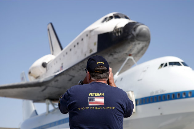 Vietnam war veteran Steve Davis take pictures of the Space Shuttle Endeavour at the NASA Dryden Flight Research Center at Edwards Air Force Base, Calif., Thursday, Sept. 20, 2012. Endeavour returned t