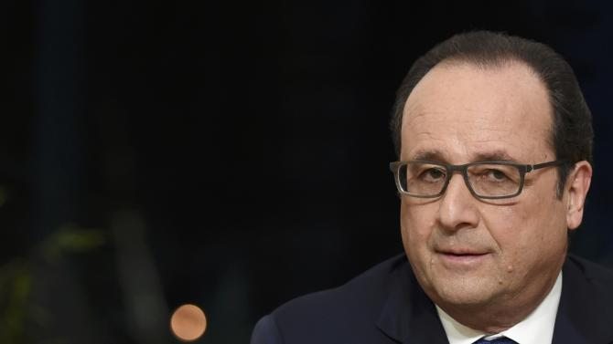 French President Hollande attends a live prime time new broadcast from the Elysee Palace in Paris