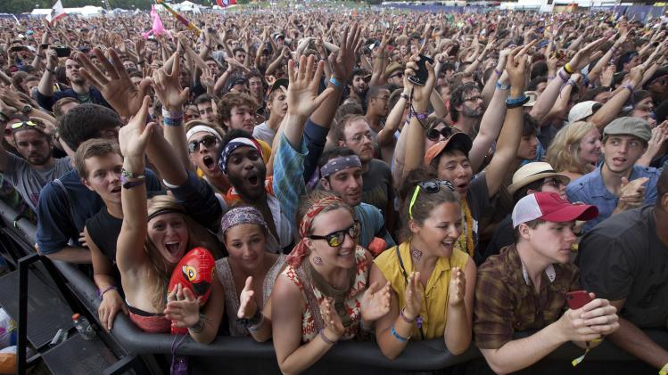 Music fans react as Bon Iver performs during the Bonnaroo Music and Arts Festival in Manchester, Tenn., Sunday, June 10, 2012. (AP Photo/Dave Martin)