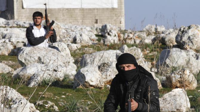Syrian rebels are seen outside of Idlib, Syria, Saturday, Feb. 11, 2012. (AP Photo)