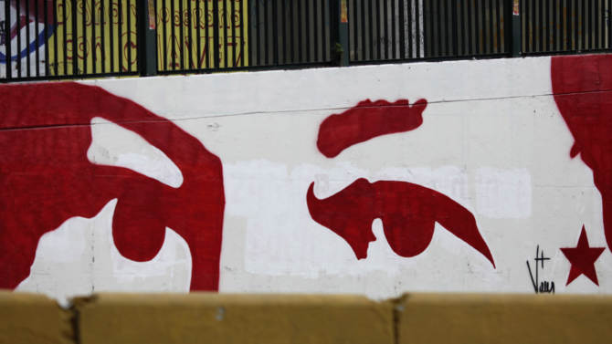 "A mural represents the eyes of Venezuela's President Hugo Chavez in Caracas, Venezuela, Monday, Dec. 31, 2012.  Chavez is confronting ""new complications"" due to a respiratory infection nearly three weeks after undergoing cancer surgery, his Vice President Nicolas Maduro said Sunday evening in Cuba as he visited the ailing leader for the first time since his operation. (AP Photo/Ariana Cubillos)"
