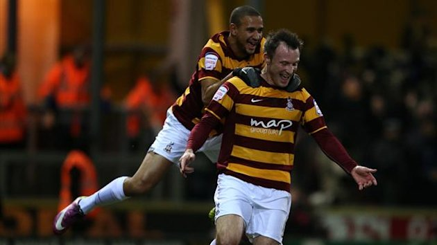 Bradford City's Garry Thompson (front) celebrates with his team-mate James Meredith (back) after scoring his team's opening goal