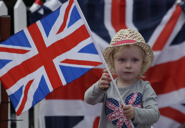 A young girl shows her support for the Great Britain team at a park screening a live telecast of the opening ceremony of the 2012 Summer Olympics, Friday, July 27, 2012, in London. (AP Photo/Ng Han Guan)