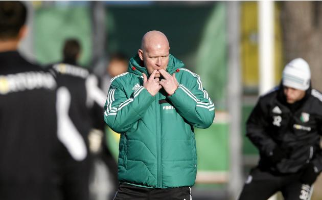 Legia Warsaw's new coach Henning Berg whistles during his first practice session with the team's players in Warsaw