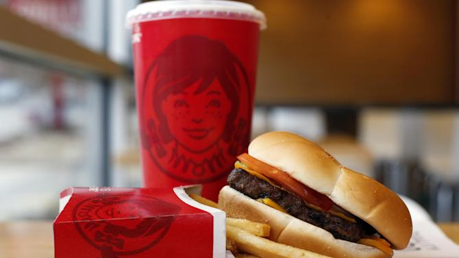 This March 17, 2014 photo shows a Wendy's single hamburger with cheese combo meal at a Wendy's restaurant in Pittsburgh. Wendy's reports quarterly earnings on Thursday, May 8, 2014. (AP Photo/Gene J. Puskar)