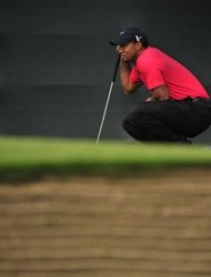 Tiger Woods of the US lines up a putt during his final round on day four of the 2012 British Open Golf Championship at Royal Lytham and St Annes in Lytham, north-west England. Ernie Els won the Open Championship and ended a 10-year major victory drought in shocking fashion on Sunday at Royal Lytham as Adam Scott squandered a four-stroke lead with four holes to play