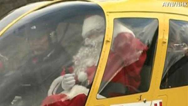 Santa brings gifts to kids in tsunami-ravaged town