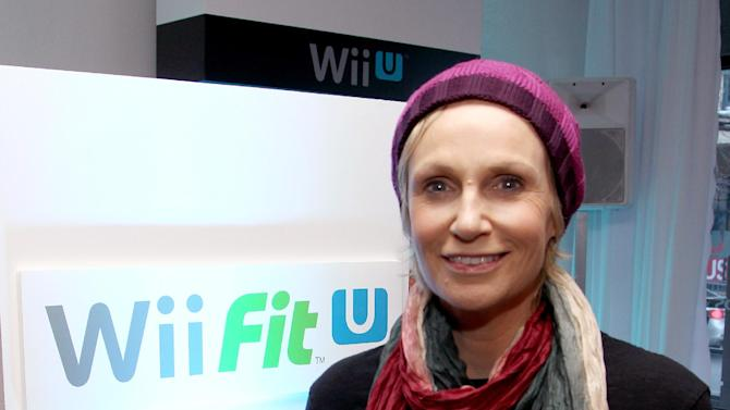 Actress Jane Lynch warms up and checks out Wii Fit U at the Nintendo Lounge during a break from the Sundance Film Festival on Saturday, January 20, 2013 in Park City, UT. (Photo by Donald Traill/Invision for Nintendo/AP Images)