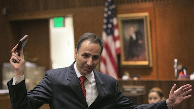 Prosecutor Habib Balian holds the wallet of Christian Karl Gerhartsreiter during final arguments in Gerhartsreiter's trial at Clara Shortridge Foltz Criminal Justice Center in Los Angeles, Monday, April 8, 2013. Closing arguments have begun in the Los Angeles trial of Gerhartsreiter, a notorious Rockefeller impostor charged with murdering a man in 1985.  (AP Photo/Damian Dovarganes)