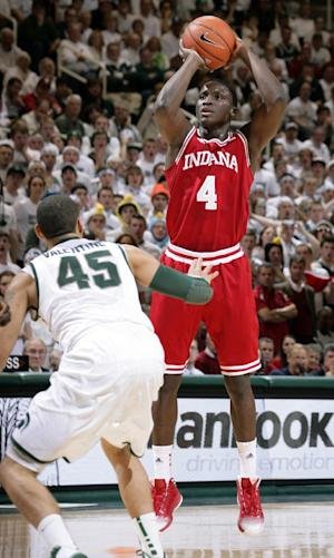 Indiana's Victor Oladipo (4) shoots against Michigan State's Denzel Valentine during the first half of an NCAA college basketball game, Tuesday, Feb. 19, 2013, in East Lansing, Mich. (AP Photo/Al Goldis)