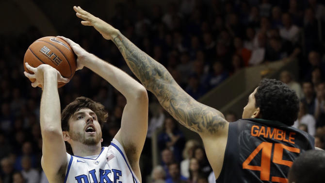 Duke's Ryan Kelly (34) shoots as Miami's Julian Gamble (45) defends during the first half of an NCAA college basketball game in Durham, N.C., Saturday, March 2, 2013. (AP Photo/Gerry Broome)